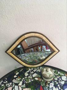 Miroir en laiton forme originale.