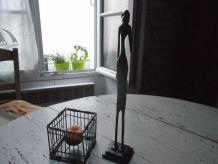 Statuette et porte bougie