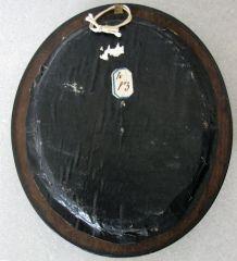 Ancien cadre ovale, bois noirci et verre bombé
