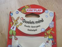 jouet osselets en metal   jamais ouvert pochette neuve