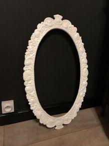 Cadre métal sculpté de miroir