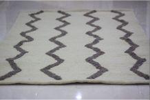 Tapis  fait main en laine couleur beige