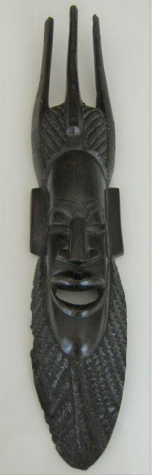 Statue masque Africain mural bois noir ébène? Semainier ?