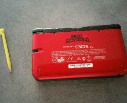 vend 3DS XL avec 2 jeux
