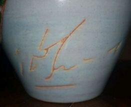 Ancien vase céramique signé