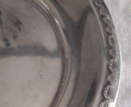 Plat ancien rond en métal argenté