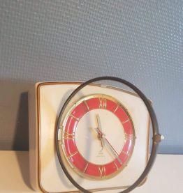 pendule Jaz vintage en bakélite blanche et rouge