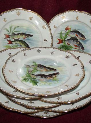 Suite de 9 assiettes à poisson Limoges
