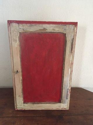 Petite armoire de rangement en bois bicolore.