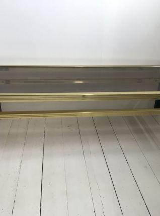Table basse en métal doré et verre fumé