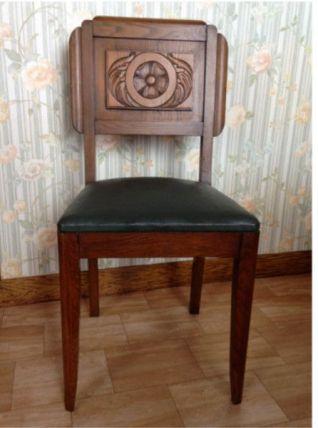 Chaises art déco en bois sculté et cuir vert