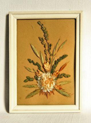 Encadrement avec fleurs séchées sous verre. Vintage.