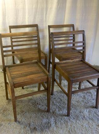 Série de 4 chaises en bois massif par René Gabriel. Années 4