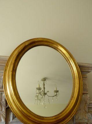 Miroir doré ovale cadre perlé