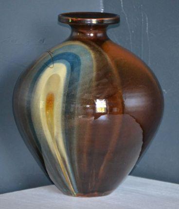 Vase boule en céramique vernis signé