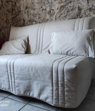 Canapé lit 2 places , couleur beige avec un tiroir de rangem