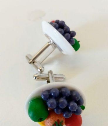 Boutons de manchette assiette de fruits colorés