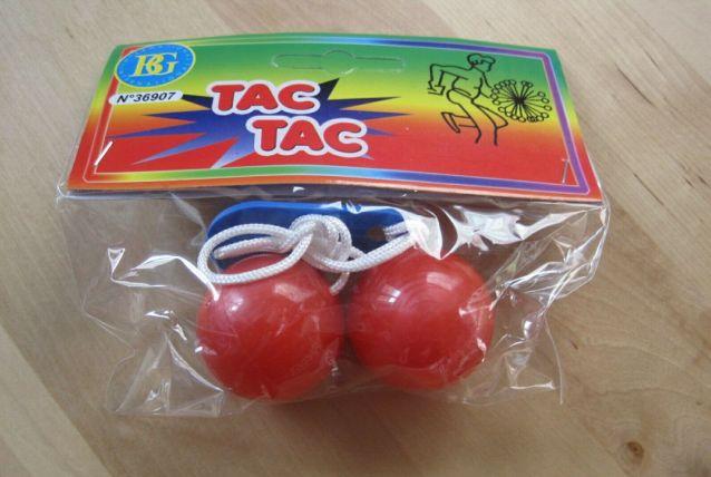 jouet tac tac dans pochette neuve couleur rouge